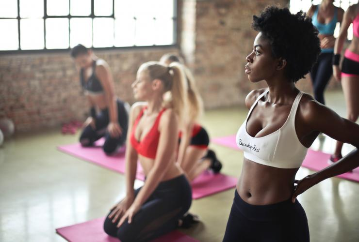 Girls in a yoga studio for a yoga class
