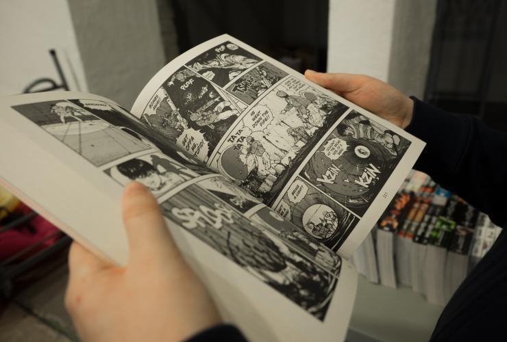 Person reading a comic book