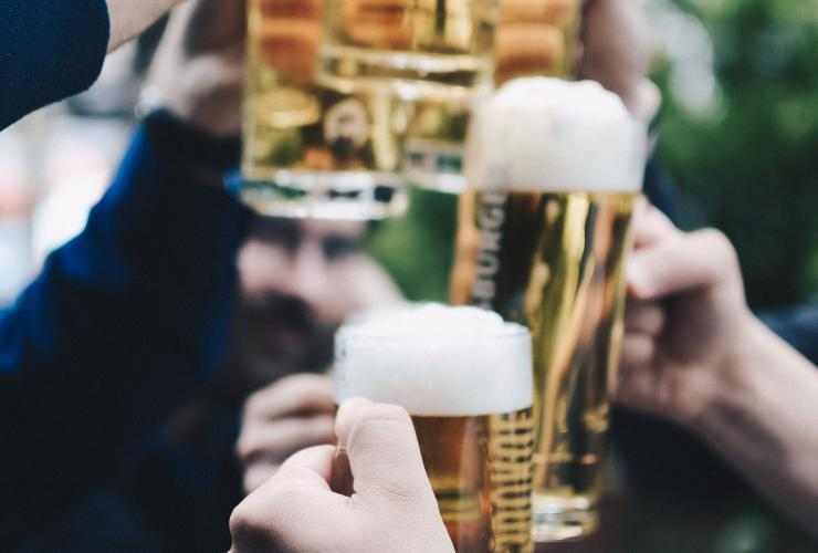 Oktoberfest beer steins people with beer